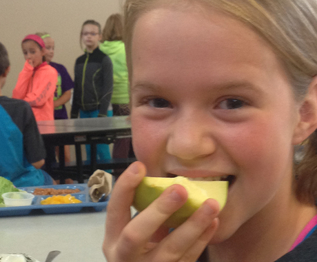 Girl biting into apple
