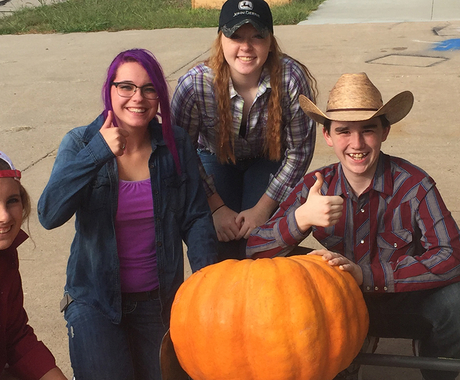 Students with giant pumpkin