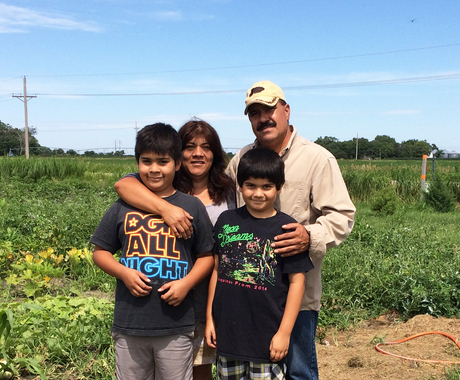 Latino family in field