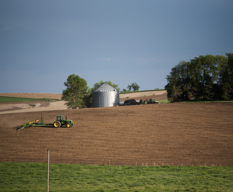 Tractor planting crops