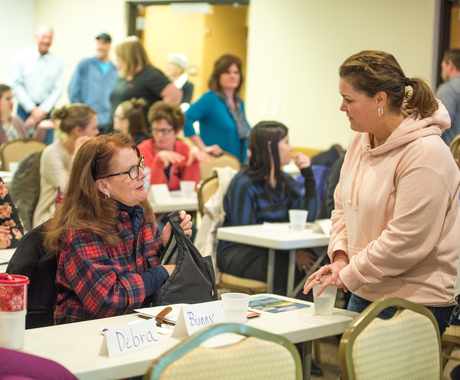 Two women networking at a workshop