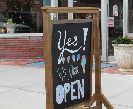 Yes we are open sign in front of ice cream shop
