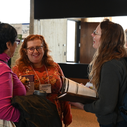 Three women networking at a conference