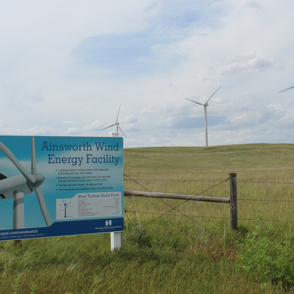 Sign for wind energy facility with wind turbines behind