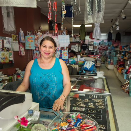 A Latino business owner in her shop