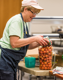 Cafeteria worker with local tomatoes